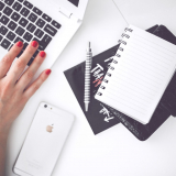 woman-hand-smartphone-desk-min